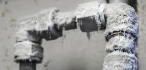 frozen pipes covered in ice